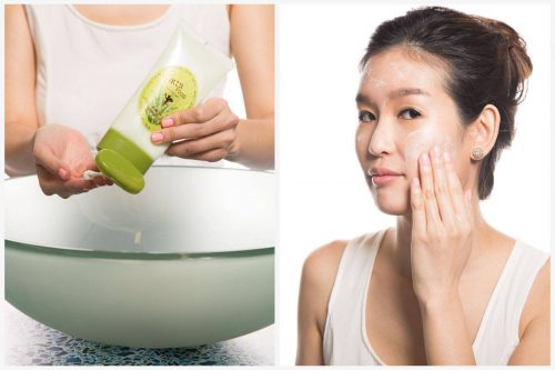 Modella asiatica intenta alla pulizia del viso con prodotti tipici.